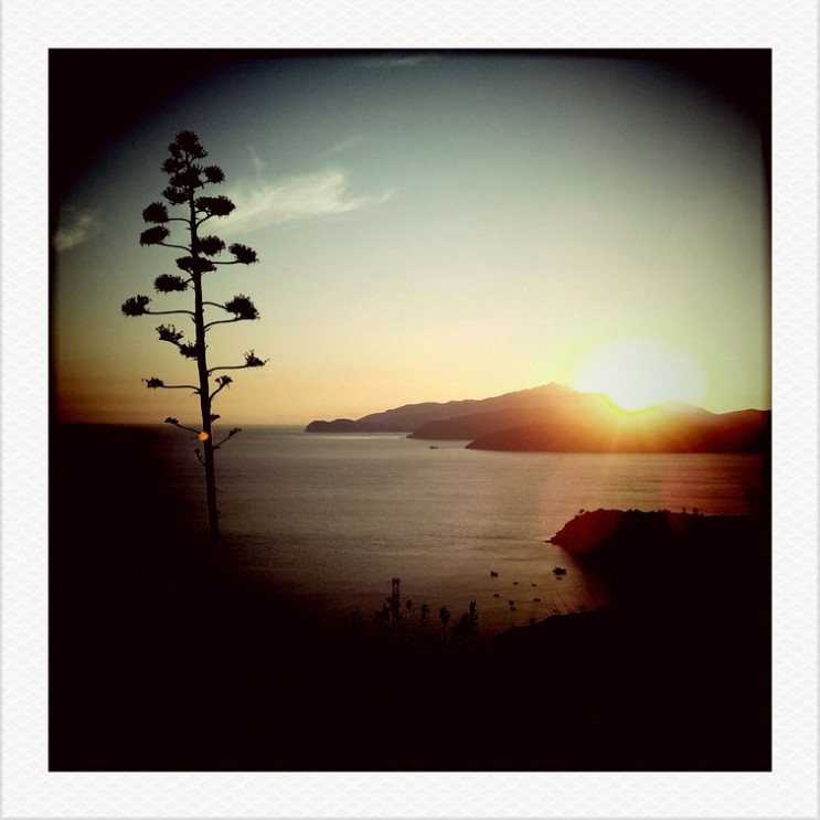 The sun sets over the Golfo di Stella on the Tuscan Island of Elba, Italy, Tuesday, August 7, 2012.