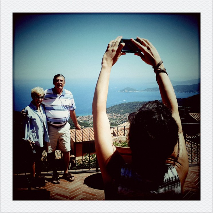 Beth takes a picture of her parents Kathy and Ray at Marciana Alta on the Tuscan Island of Elba, Italy, Wednesday, August 8, 2012.