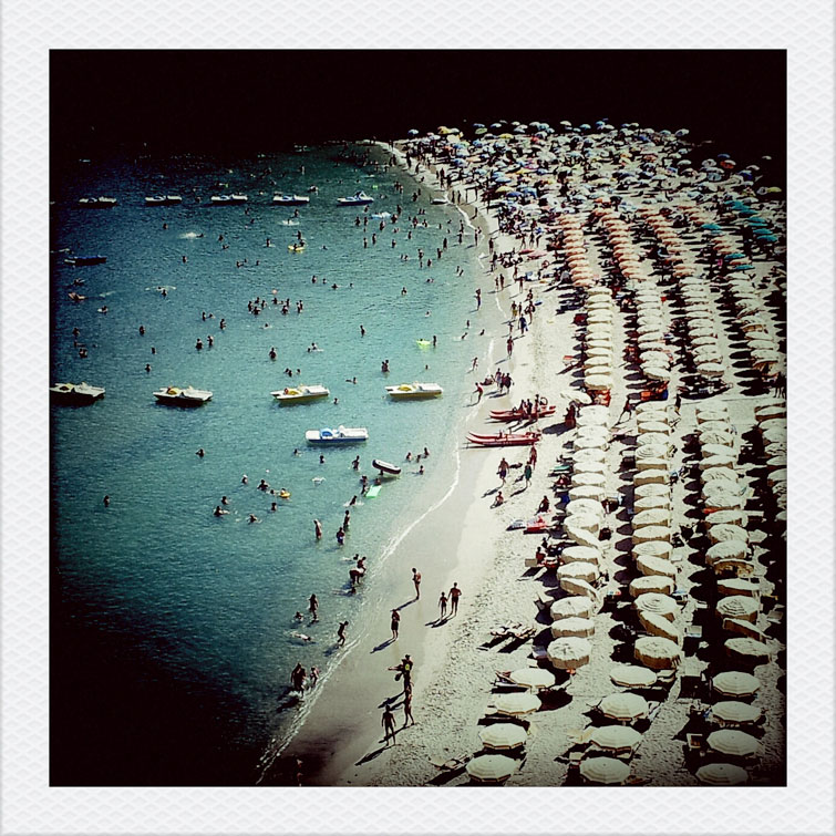 Tourist crowds at Fetovaia beach on the Tuscan Island of Elba, Italy, Wednesday, August 8, 2012.
