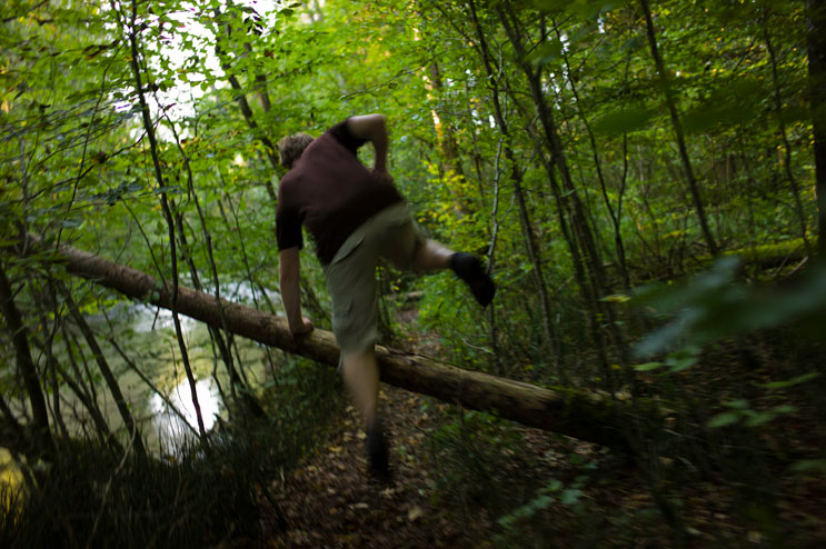 Our friend Tobi takes a leap over a fallen tree during a hike along the Mangfall river near Hohendilching, Sunday, September 9, 2012.