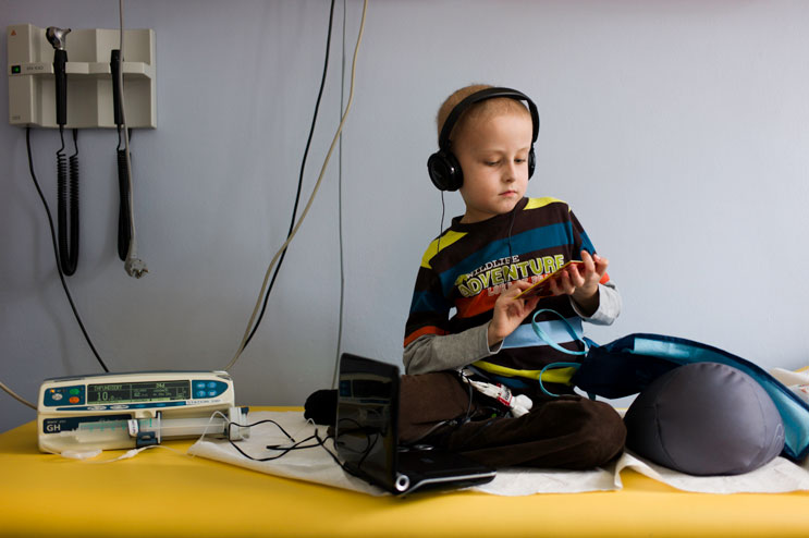 Seven-year-old Stefan picks a movie for his portable DVD-player as he is about to receive a several-hour-long round of chemo in the out-patient station of the children cancer ward at the hospital München Schwabing in Munich, Thursday, October 11, 2012. Stefan was diagnosed with Leukemia when he was six.