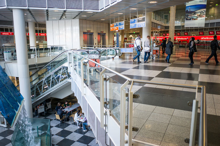 """The family sits in their """"living room,"""" the restaurant on the ground floor of section A at Terminal 1. """"One room for three,"""" Sakis said about what they needed most at this point. """"Twenty (square) meters, ... only the walls. Nothing else."""" Saturday, November 24, 2012."""