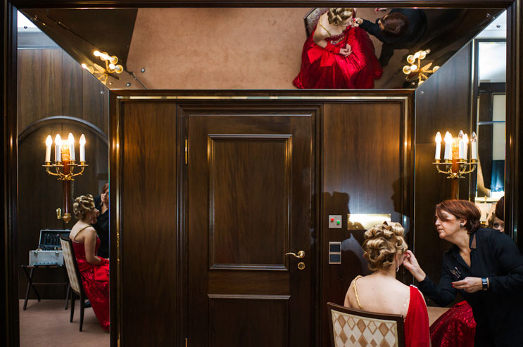 Hair and make-up artist Dilek Sahin puts the finishing touches on the make-up of Narrhalla Princess Astrid I. (Astrid Dengler) in her suite at the hotel Bayrischer Hof before the enthronement ceremony at Marienplatz in Munich. Saturday, January 12, 2013.