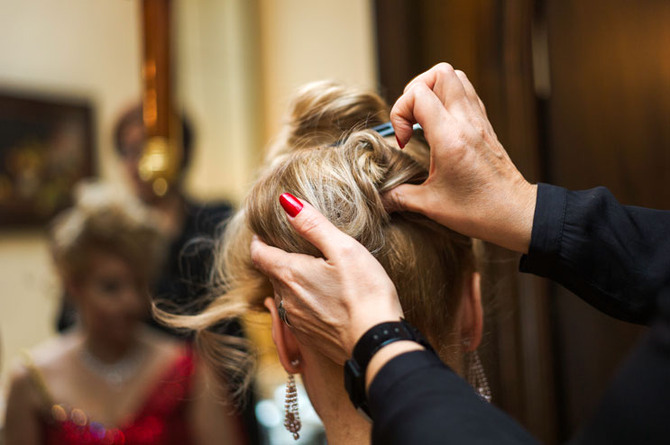 Hair and make-up artist Dilek Sahin fixes the hair of Narrhalla Princess Astrid I. (Astrid Dengler) in her suite at the hotel Bayrischer Hof before the enthronement ceremony at Marienplatz in Munich. Saturday, January 12, 2013.