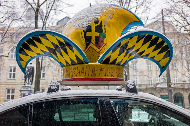 """The previous year's prince and """"royal"""" driver Niklas Schreier takes Narrhalla Prince Manuel I. (Manuel di Nardo) and Princess Astrid I. (Astrid Dengler) to Marienplatz for the enthronement ceremony. Saturday, January 12, 2013."""